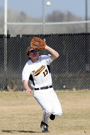Thompson Valley High School center fielder Karsen Buschjost eyes a fly ball before catching it in the top of the fourth inning of a game against Northridge on Tuesday, March 30, 2010 at Constanz Field. The Eagles lost, 19-11.