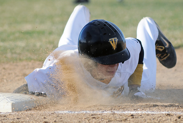 Thompson Valley High School sophomore Chris Sievers dives back to first base on a pickoff attempt in the bottom of the sixth inning of a game against Northridge on Tuesday, March 30, 2010 at Constanz Field. The Eagles lost, 19-11.