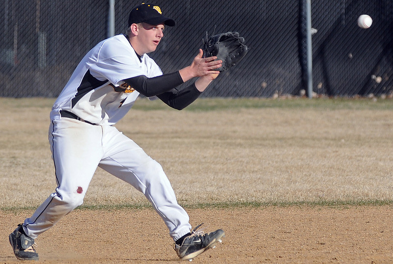 Thompson Valley High School junior Jeremy White fields a ground ball in the top of the fifth inning of a game against Northridge on Tuesday, March 30, 2010 at Constanz Field. The Eagles lost, 19-11.