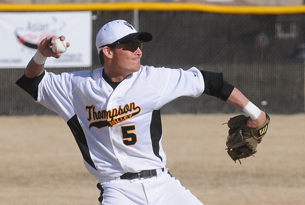 Thompson Valley High School shortstop Chaz Moore rears back to make the throw to first base after fielding a ground ball in the top of the first inning of a game against Fossil Ridge on Tuesday, March 22, 2011 at Constantz Field. The Eagles won, 30-12.