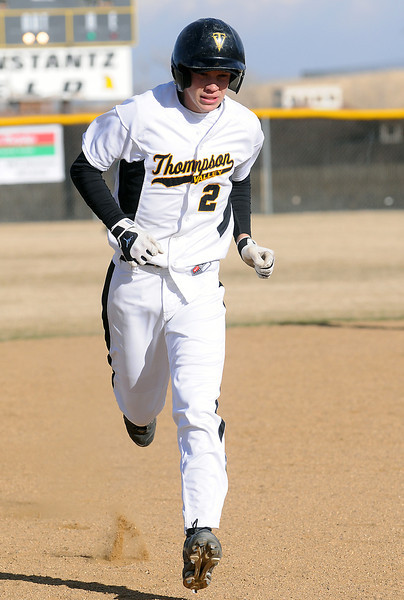 Thompson Valley High School junior Chris Sievers rounds the bases after hitting a two-run home run in the bottom of the second inning of a game against Fossil Ridge on Tuesday, March 22, 2011 at Constantz Field.
