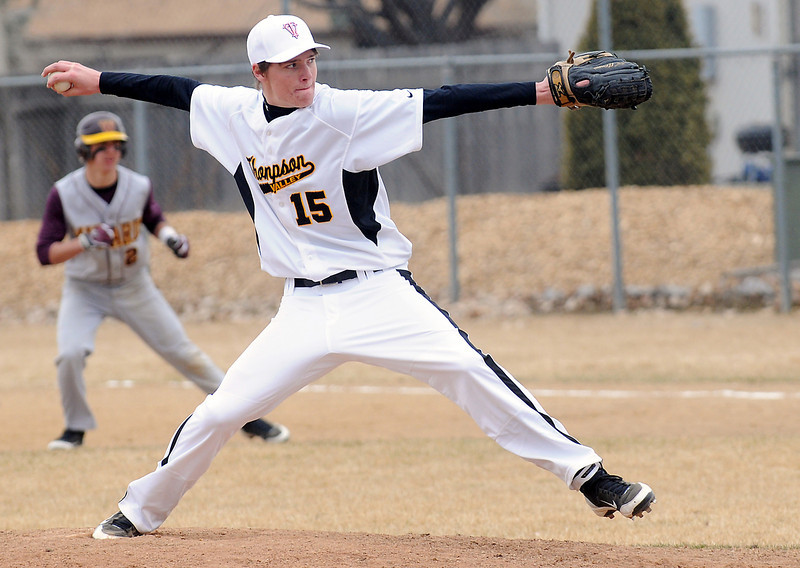 Thompson Valley High School junior Cole Mueller winds up before throwing a pitch in the top of the fifth inning of a game against Windsor on Saturday, March 12, 2011 at Constantz Field.
