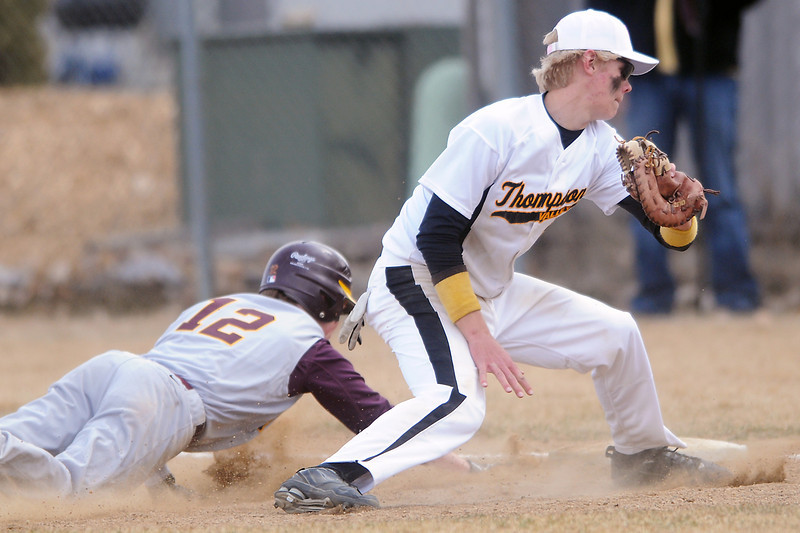Thompson Valley High School first baseman Chris Sievers spins around in an unsuccessful attempt to pick off Windsor baserunner Matt Lee in the top of the third inning of their game on Saturday, March 12, 2011 at Constantz Field. The Eagles lost, 3-2.