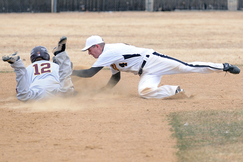 Windsor High School's Matt Lee, left, safely dives back to second base ahead of the pickoff attempt by Thompson Valley second baseman Jeremy White in the top of the fifth inning of their game on Saturday, March 12, 2011 at Constantz Field. The Eagles lost, 3-2.