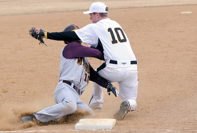 Thompson Valley High School third baseman Mike Lewis, right, collides with Windsor's Drake Shepit after tagging him out on a steal attempt in the top of the sixth inning of their game on Saturday, March 12, 2011 at Constantz Field. The Eagles lost, 3-2.