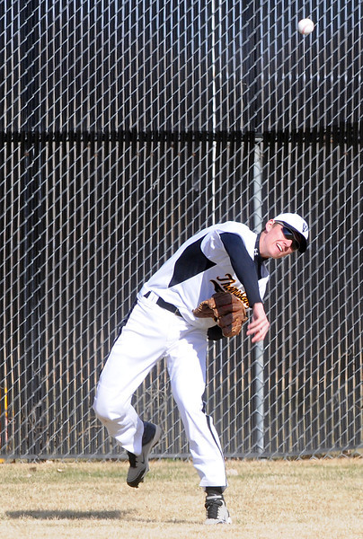 Thompson Valley High School center fielder Karsen Buschjost throws the ball to the infield after fielding the ball in the top of the first inning of a game against Fossil Ridge at Constantz Field.
