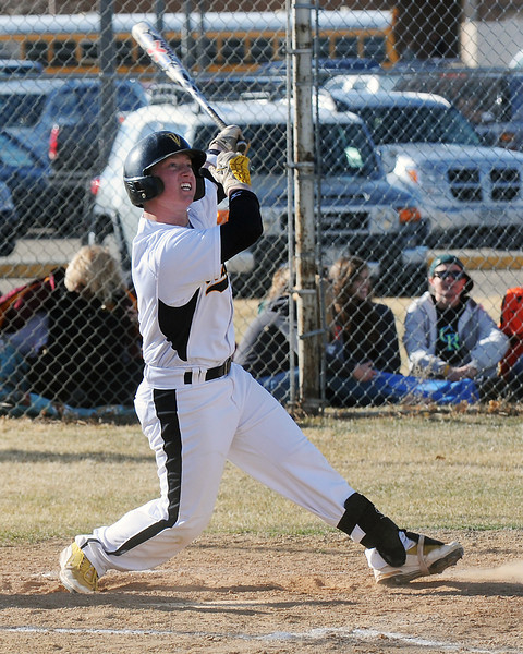 Thompson Valley High School junior Kyle Kelly follows through while hitting a grand slam in the bottom of the second inning of a game against Fossil Ridge on Tuesday, March 22, 2011 at Constantz Field.