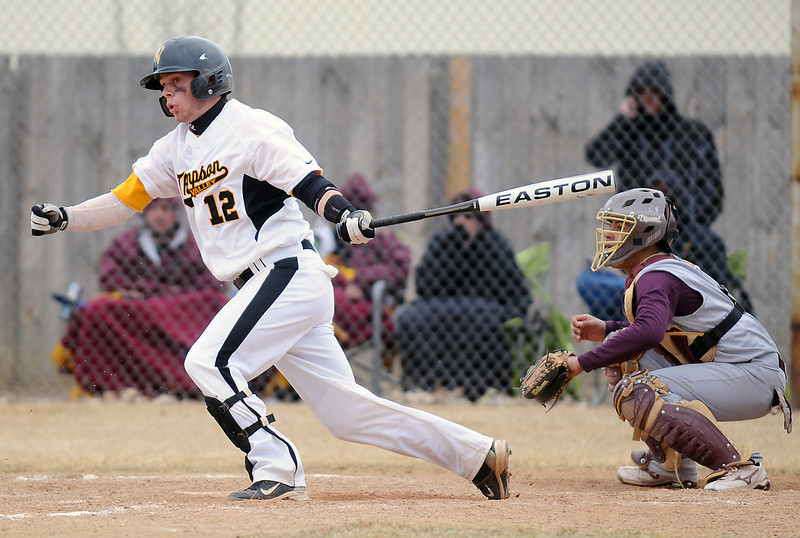 Thompson Valley High School senior Max Schoen takes off for first base after hitting a single while Windsor catcher Greg Medina looks on in the bottom of the fifth inning of their game on Saturday, March 12, 2011 at Constantz Field. The Eagles lost, 3-2.