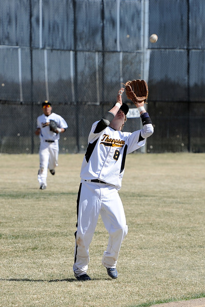 Thompson Valley High School shortstop Garrett smith catches a fly ball for an out in the top of the fifth inning of a game against Broomfield on Saturday, March 24, 2012 at Constantz Field.