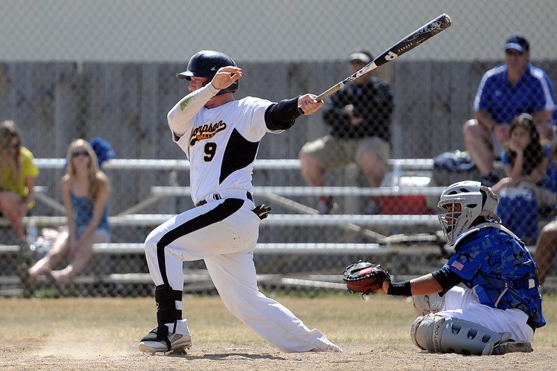 Thompson Valley High School senior Kyle Kelly follows through after hitting a single in front of Broomfield catcher Ben Martinez in the bottom of the fourth inning of their game Saturday, March 24, 2012 at Constantz Field.