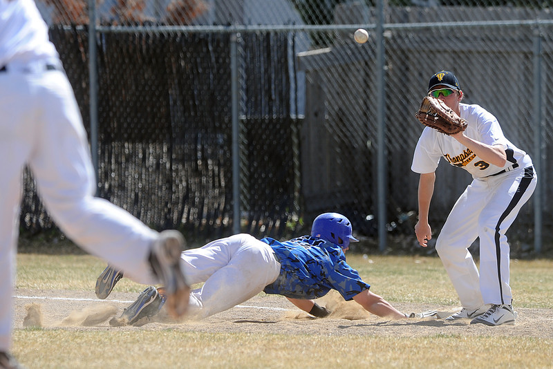 Thompson Valley High School first baseman Karsen Buschjost, right, awaits the throw from pitcher Chris Sievers, left, on an unsuccessful pickoff attempt of Broomfield baserunner Jordan Arensdorf in the top of the fourth inning of their game Saturday, March 24, 2012 at Constantz Field.