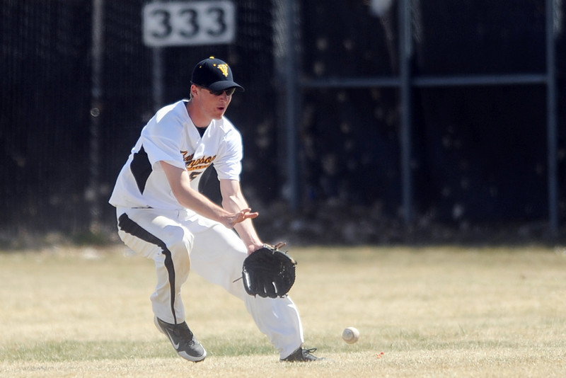 Thompson Valley High School's Cole Mueller converges on a ball hit to right field in the top of the sixth inning of a game against Broomfield on Saturday, March 24, 2012 at Constantz Field.