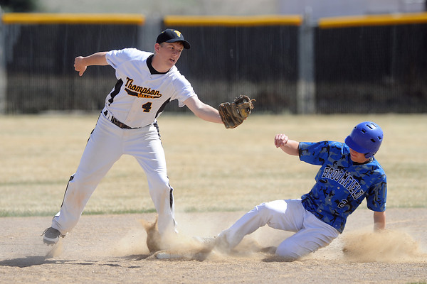 Thompson Valley High School senior Jeremy White steps on second base to force out Broomfield baserunner Ryan McCulley in the top of the fourth inning of their game Saturday, March 24, 2012 at Constantz Field.