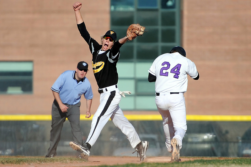 Mountain View High School baserunner Ty Porterfield is safe at first base for a single in front of Thompson Valley's Chris Sievers in the top of the fifth inning of their game Thursday, March 29, 2012 at Brock Field.