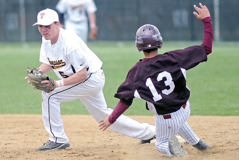 Thompson Valley High School shortstop Chaz Moore touches second base to force out Berthoud baserunner Vinny Grine in the top of the third inning of their game on Saturday, May 1, 2010 at Constantz Field. The Eagles won in five innings, 12-2.