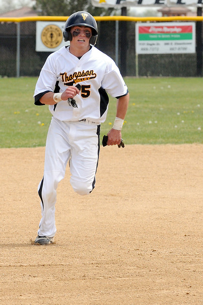 Thompson Valley High School's Chaz Moore sprints for third base during a game against Mountain View on Saturday, May 7, 2011 at Constantz Field.