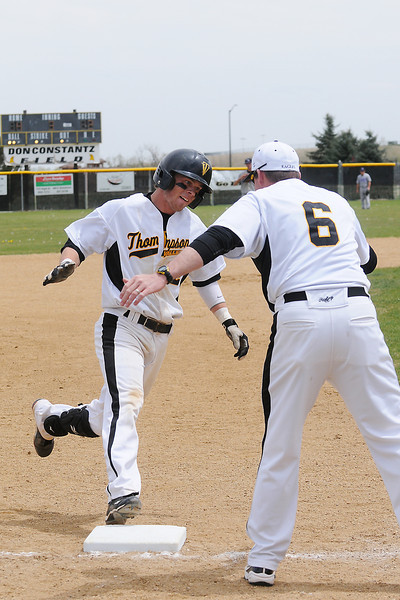 Thompson Valley High School senior Max Schoen is congratulated as he rounds third base by head coach Jay Denning after hitting a home run in the bottom of the third inning of a game against Mountain View on Saturday, May 7, 2011 at Constantz Field.