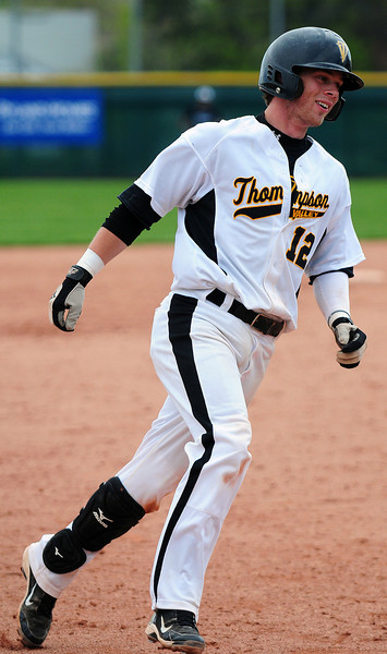 Max Schoen (12) rounds third base Saturday morning after a hitting a home run at All Star Park in Lakewood. Thompson Valley lost to Pueblo West despite a 4-run rally in the sixth inning with a final score of 10-9.