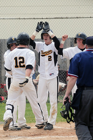 Thompson Valley High School's Max Schoen (12) is congratulated by teammates after hitting a home run during a game against Mountain View on Saturday, May 7, 2011 at Constantz Field.