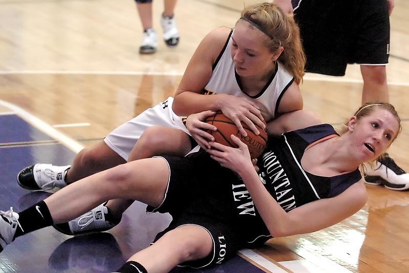 Mountain View High School's Erin Stumbaugh, right, battles for control of a loose ball with Thompson Valley's Alexis Hunt in the second quarter of their game on Saturday, Dec. 5, 2009 at Fort Collins High School.