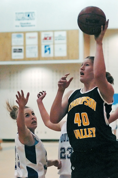 Thompson Valley High School junior Jordan Sibrel takes a shot over Poudre's Danielle Mayer in the  third quarter of their game on Tuesday, Dec. 1, 2009 at PHS.