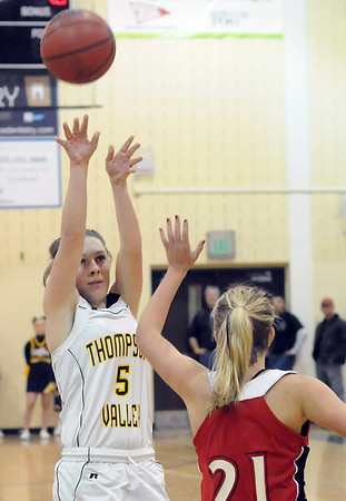Thompson Valley High School junior Lauren Mickelson (5) shoots over Loveland defender Hadley Vaughn (21) in the first quarter of their game Friday night at TVHS. The Eagles won, 50-39.