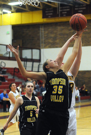 Thompson Valley High School junior Skylar Marshall (35) and Berthoud's Tanya Bezanson battle for a rebound while Lauren Mickelson looks on in the first quarter of their game Thursday at BHS.