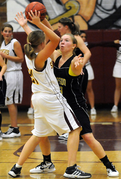 Thompson Valley High School senior Alexis Hunt, right, applies defensive pressure to Berthoud's Lindsey Loberg in the third quarter of their game Thursday at BHS. The Eagles won, 54-28.