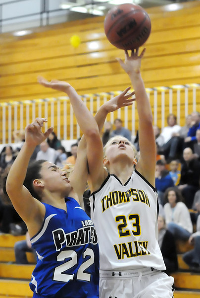 Thompson Valley High School senior Sydney Paulsen is foulded by Alameda's Ilanna Gorjoux as she attempts a shot in the second quarter of their playoff game on Tuesday, Feb. 23, 2010 at TVHS.