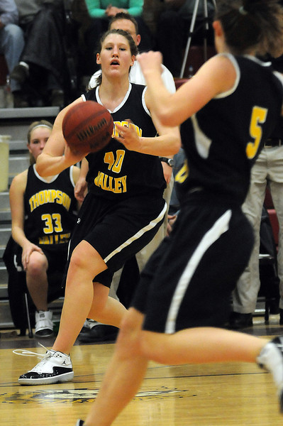 Thompson Valley junior Jordan Sibrel, background, passes to sophomore Lauren Mickelson during a fast break in the third quarter of Tuesday night's game at Berthoud High School. The Eagles won the game 52-40.