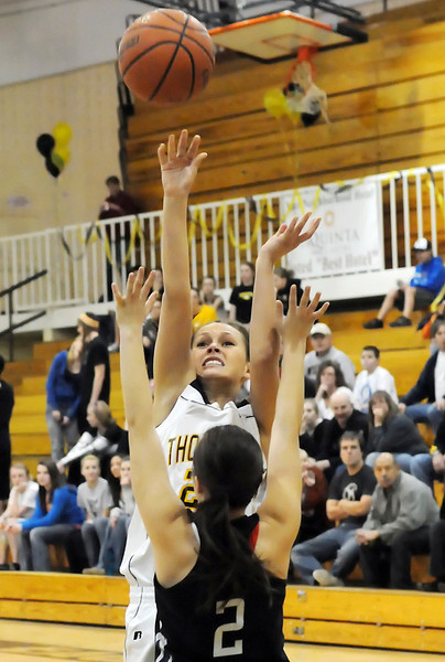 Thompson Valley High School senior Brooke Podtburg, back, puts up a shot over Mountain View's Brittney Bjork in the first quarter of their game Thursday night at TVHS.