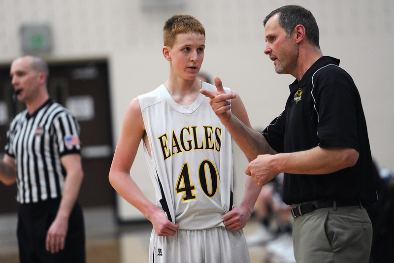 Thompson Valley High School boys head basketball coach Josh Robinson, right, talks to sophomore Collin Smith during a break in the action of a game against Frederick on Tuesday, Feb. 21, 2012 at TVHS.