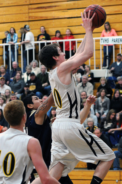 Thompson Valley High School junior Jonny Pomerleau, right, puts up a shot in front of Frederick's Zach Gomez in the second quarter of their game Tuesday, Feb. 21, 2012 at TVHS.