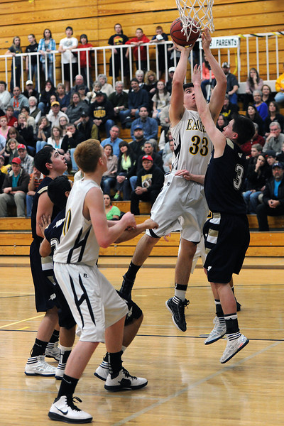 Thompson Valley High School junior Sam Baca (33) puts up a shot over Frederick's Lucas Adams in the second quarter of their game Tuesday, Feb. 21, 2012 at TVHS.
