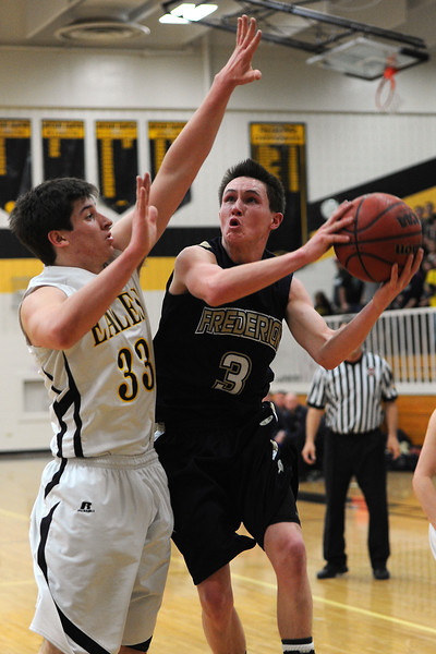 Thompson Valley High School junior Sam Baca, left, defends against Frederick's Lucas Adams as he drives to the basket in the second quarter of their game Tuesday, Feb. 21, 2012 at TVHS.