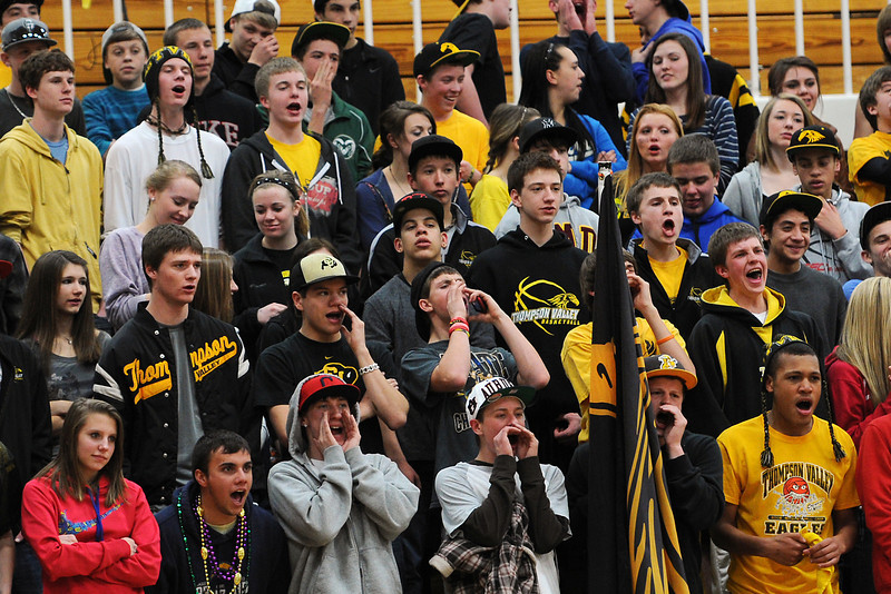Thompson Valley High School basketball fans cheer on the boys team as they take on Frederick on Tuesday, Feb. 21, 2012 at TVHS.