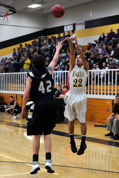 Thompson Valley High School sophomore Estevan Garcia, right, shoots a jump shot over Frederick's Jayden McGraw in the third quarter of their game Tuesday, Feb. 21, 2012 at TVHS.