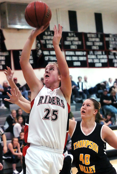 Roosevelt High School junior Kaitlin Flynn puts up a shot in front of Thompson Valley's Jordan Sibrel in the first quarter of their game on Tuesday, Jan. 5, 2010 at RHS.
