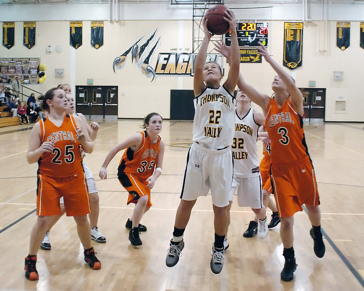 Thompson Valley High School junior Brooke Podtburg (22) battles for a rebound with Greeley Central's Nicole Cousins (3) in the third quarter of their game on Thursday, Jan. 28, 2010 at TVHS.