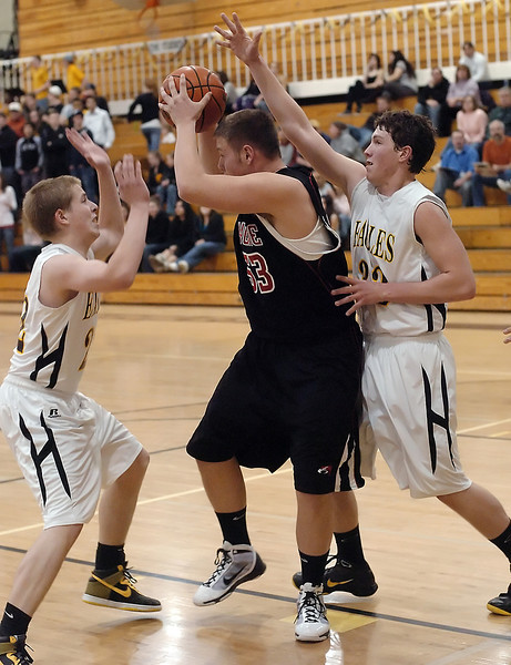 Thompson Valley High School teammates Zac McMorris, left, and Corey Dyer apply defensive pressure to Skyline's Mason Chambers in the third quarter of their game Tuesday, Jan. 26, 2010 at TVHS.