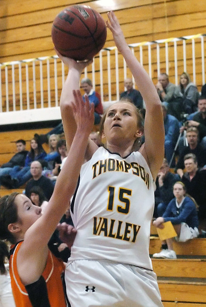 Thompson Valley High School junior Kenzie Archer takes a shot over Greeley Central's Kirsten Denham in the second quarter of their game Thursday, Jan. 28, 2010 at TVHS.