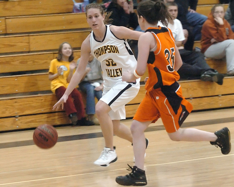 Thompson Valley High School senior Morgan Sibrel dribbles around Greeley Central's Katerina Smallcomb in the third quarter of their game on Thursday, Jan. 28, 2010 at TVHS.