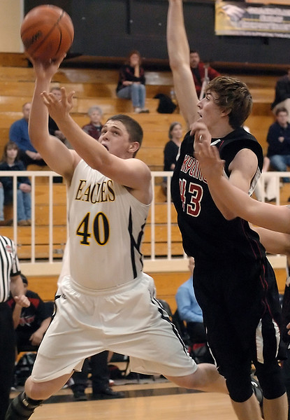 Thompson Valley High School junior Caleb Carlson goes up for a shot in front of Skyline's Brandon Dabney in the first quarter of their game Tuesday, Jan. 26, 2010 at TVHS.