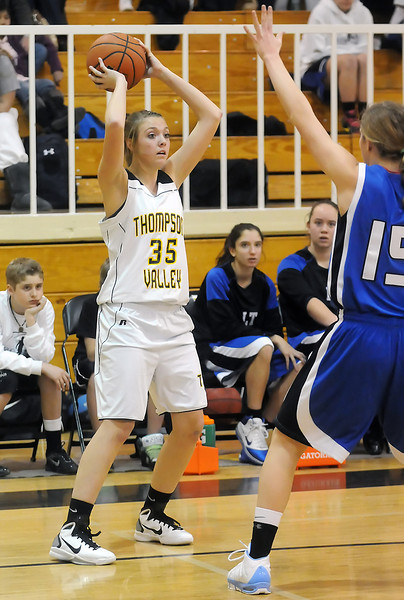 Thompson Valley High School junior Skylar Marshall (35) looks for an open teammate to pass to during a game against Longmont on Friday, Jan. 21, 2011 at TVHS. The Eagles lost, 57-37.