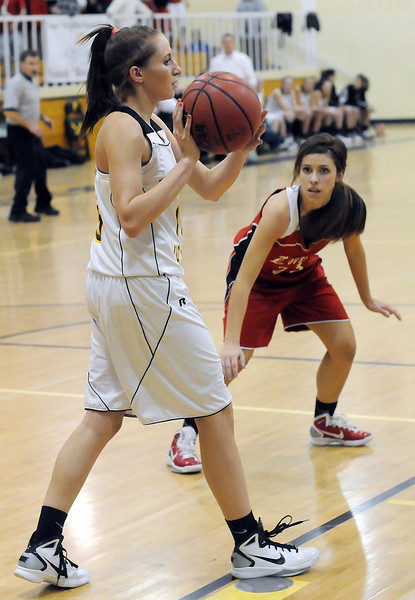 Thompson Valley High School senior Kenzie Archer, left, looks for an open teammate under defensive pressure from Loveland's Michelle Petrie during a recent game last December at TVHS.