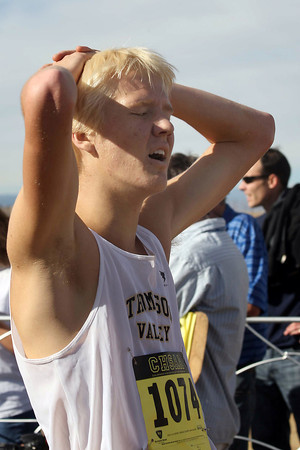 Thompson Valley High School's Gus Waneka rests after competing in a class 4A State Cross Country Championship at the Arapahoe County Fairgrounds on Oct. 30 in Aurora. (Heather A. Longway/ The Reporter-Herald)