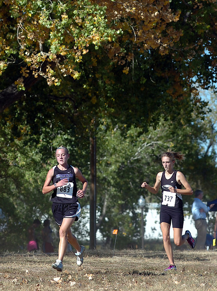 MV's McKayla Gray, front, and TV's Karina Ernst run during a cross country meet Thursday.