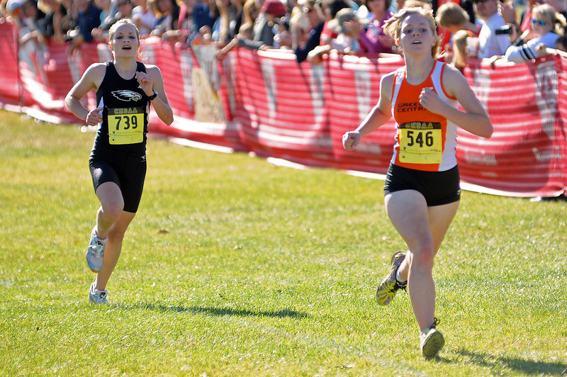 Thompson Valley High School senior Becky Schmitt, left, makes an effort to best Allie Parks of Greeley Central during the 5A State Cross Country Championships on Saturday at Fossil Ridge High School in Fort Collins.