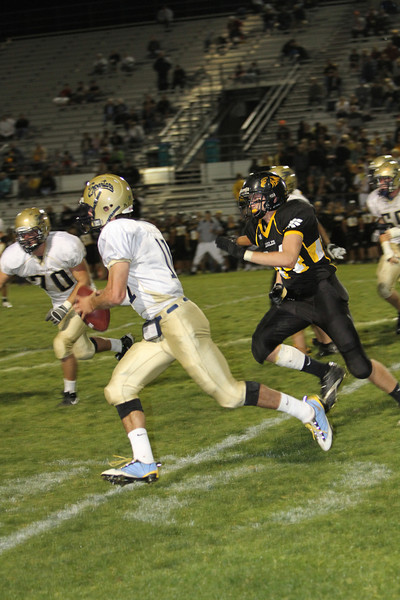 Thompson Valley junior #84 Cody Anderson forces Greeley West quarterback #11 out of the pocket in the second quarter. <br /> Photo by Jenn LeBlanc