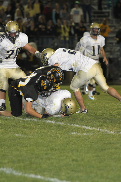 Thompson Valley seniors Boe Coleson and Turner McFadden tackle Greeley West #5<br /> Photo by Jenn LeBlanc